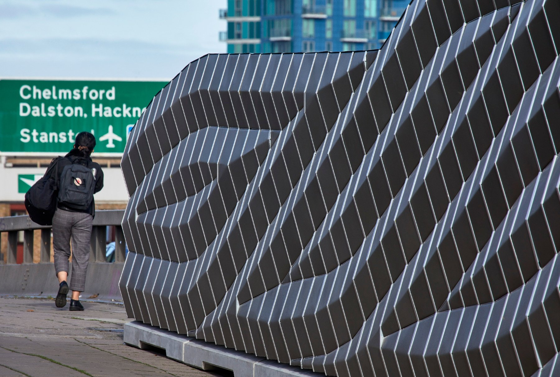 Absorptive highway traffic noise wall